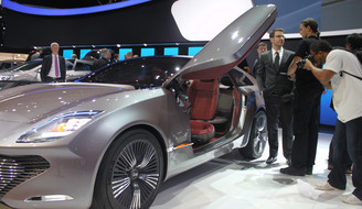 Gullwing doors. Of course, it